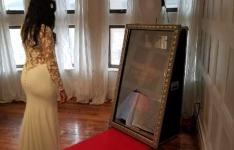 Bride taking an Ultimate Selfie Mirror Photo Booth