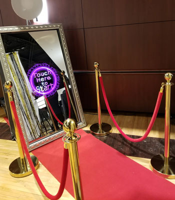 Photo Booth Rental setup with Mirror Me provided by Red Carpet Images